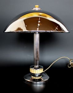 An Art Deco dome lamp with reeded chromed metal stem and a section of reeded bakelite to base. Bakelite finial to top.
