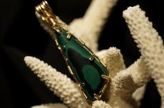Wire Wrapped Pendant Malachite Gemstone Cabochon  14k Gold filled wire. $64.00, via Etsy.