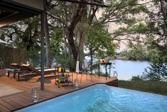 Thorntree River Lodge is a contemporary tented camp just 20 minutes upstream from Victoria Falls. A riverside haven on the shores of the Zambezi. Rhino Africa, Safari, Destinations, River Lodge, Outdoor Bathrooms, 2nd City, Kwazulu Natal, Victoria Falls, Plunge Pool
