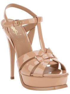 Nude calf leather 'Tribute' sandal from Yves Saint Laurent featuring an interwoven front design, a t-bar strap to the top, a buckle fastening ankle strap, a leather covered platform and a leather covered stiletto heel.