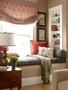 Make the area as inviting as it is functional by hanging artwork and accessorizing with pretty, plush fabrics. Love the roman shade!