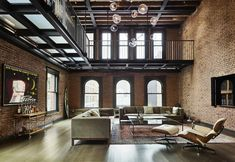 Living area with lots of exposed brick sits beneath a metal catwalk in this loft in New York City. 993 area with lots of exposed brick sits beneath a metal catwalk in this loft in New York City. Duplex New York, New York Penthouse, New York Loft, Penthouse Apartment, Apartment Goals, Apartment Guide, Urban Apartment, Apartment Styles, Luxury Penthouse