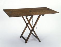 Table        Place of origin:        Italy (made)      Date:        1500-1550 (made)      Materials and Techniques:        Walnut with boxwood, rosewood and bone inlay, the trestle support with iron chains