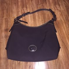 Dooney & Bourke Nylon Bag (Authentic) Used a few times. Good condition. Nylon bag. Real leather straps. Inside pouch. 4 pockets inside. Dooney & Bourke Bags Totes