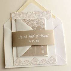 Elegant wedding invitation with vintage lace design and belly band. Shown in champagne color print.