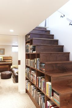 Book shelves on the side of stairs.