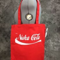 Hand painted red bag with Nuka Cola design on it. Design is painted in white on one side only. Perfect for conventions, trips to the comic shop, as a reusable shopping bag or as a purse.  Red 100% cotton canvas promo bag (thinner than reg. canvas bags from the craft store), Self fabric handles,...
