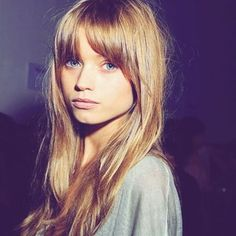 A choppy fringe is the perfect way to frame your face, this centre-parted style is super flattering for heart-shaped faces.