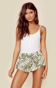 """The Mink Pink Shady Fronds Shirred Shorts feature an elasticized waist with the brands signature palm print. ImportedDry Clean Only100% PolyesterFit Guide:Model is 5ft 8 inches; Bust: 34"""", Waist: 25"""", Hips: 36""""Model is wearing a size XSRelaxed FitShoes Featured Not Available For Purchase"""