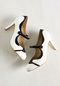 Meet for Malts Heel in Licorice. After snapping into these cream-colored heels, you trot to the ice cream parlor to share a shake with your sweetie. #white #modcloth