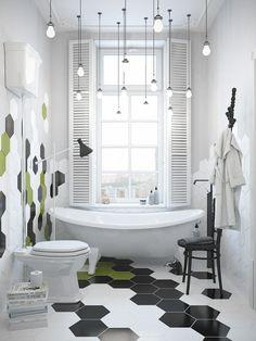 salle de bains blanche de style scandinave avec carrelage hexagonal en noir, blanc et vert pistache, baignoire îlot et suspensions ampoules