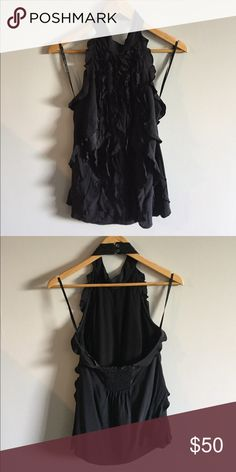 {BCBGMaxAzria} Black Halter Top. Size XS. BCBGMaxAzria top. Ruffled detailing. Halterneck. Open elastic back. 100% silk. Worn once. Excellent condition. Too big on me. BCBGMaxAzria Tops