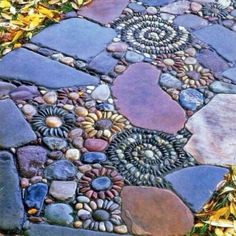 Spreading decorative pebbles around plants or laying them between pavers are just two ways to enjoy this backyard landscaping material, its texture, shapes and colors. Using decorative pebbles in contrasting colors makes striking decoration patterns. Outdoor Projects, Garden Projects, Art Projects, Dream Garden, Home And Garden, Herb Garden, Spiral Garden, Garden Modern, Diy Garden