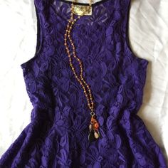 """Free People """"Miles of Lace"""" Dress Lovely purple sheer lace dress with a snap-in black slip underneath.  In perfect condition except for a undone seam in the side of the slip (see last pic) which I will mend by hand before shipping.  Material has stretch.  Size small, measures about 16"""" across bust, 15"""" across waist, 33"""" in total length (skirt is 18""""). Free People Dresses Mini"""