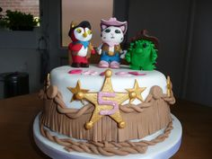 A Sheriff Callie Birthday Cake with a cowgirl fringe detail, sheriff badges and the three main characters from the show 'Sheriff Callie's wild west' on Disney Junior. The perfect centre piece for any Sheriff Callie Party.