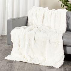 9165fa45df This white rabbit fur blanket is made with authentic rabbit fur pelts. The  fur is