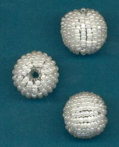 seed bead wrapped beads http://www.jansjewels.com/other/bmisc-1.html