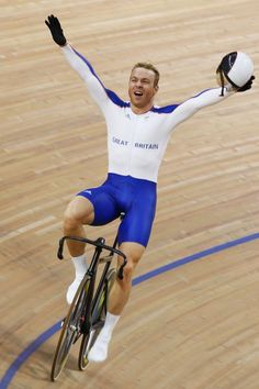 Inspirational Moments: Olympic celebrations - BEIJING - AUGUST 19: Chris Hoy of Great Britain celebrates the gold medal after defeating Jason Kenny of Great Britain in the Men's Sprint Finals in the track cycling event at the Laoshan Velodrome on Day 11 of the Beijing 2008 Olympic Games on August 19, 2008 in Beijing, China. (Photo by Jamie Squire/Getty Images)