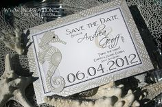 A 5x7 single sided save the date on white micah kaleidoscope with an elaborate sea horse die cut and black bling.