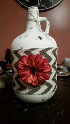 Wine Jug remade with chalk paint and decoupage glue, with a flower. Wine Jug Crafts, Mason Jar Crafts, Mason Jars, Large Wine Bottle, Wine Bottle Art, Diy Crafts For Gifts, Fall Crafts, Recycled Glass Bottles, Jar Art