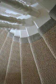 hallway flooring A curved staircase No problem with our bespoke Make Me a Rug service - look at this stunning example in our Sisal Herringbone flooring with a single linen bound edge, Supplied and installed by St James Carpet Company Staircase Carpet Runner, Stairway Carpet, Natural Carpet, Dark Carpet, Beige Carpet, Modern Carpet, Brown Carpet, Sisal Carpet, Rugs On Carpet