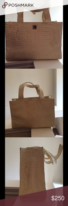 Dooney & Bourke Handbag Pale yellow leather embossed limited Edition bag. In excellent condition. Dooney & Bourke Bags