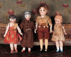 """German All-Bisque Flapper Dolls  3""""-4"""" (8-10 cm.) Each is all-bisque with painted hair and facial features,jointed limbs,the larger boy with glass eyes,various styles of painted shoes and socks. Condition: generally excellent. Comments: Germany,circa 1920. Value Points: the dolls wear original factory costumes,included is """"Aviator"""" with modeled helmet and spectacles,aviator suit."""