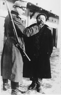 A German policeman publicly humiliates a Jew in the Zawiercie ghetto by shaving his beard.Zawiercie Getto was one of the first gettos the Nazis started Sept Ww2 History, Jewish History, German Soldier, Persecution, World War Ii, Wwii, Crime, The Past, Germany