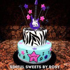 Buttercream rock star cake with fondant guitar topper