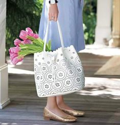 Say hello to your new everyday bag! The Perforated Leather Bucket Hobo from the Savannah Blooms Collection is lightweight & great for carrying everything you need to get you through your day. Shop the style now: