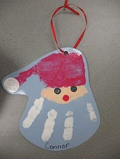 On the back: When you hang this ornament from year to year, I hope it brings a smile from ear to ear This handprint Santa, will help you remember, how small I was in 2010, in the month of Dec.