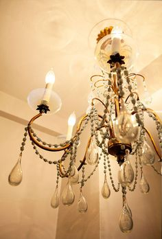 This makes me think of the chandelier I had in my room as a girl... love it!