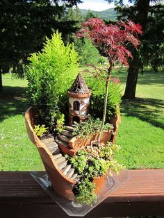 broken-pot-fairy-garden Very cool idea for reusing broken pots....check them out!   http://www.boredpanda.com/broken-pot-fairy-garden/