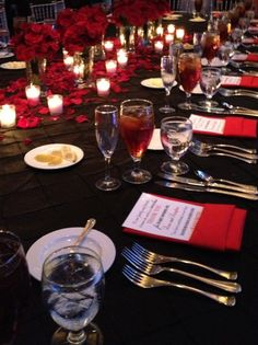 Exquisite place settings in black, white, and red for Kanika and Drew's Reception at The Capital City Club, in Montgomery, Alabama. Check out our website to see more of our beautiful weddings and events! idoidoweddingplanning.com