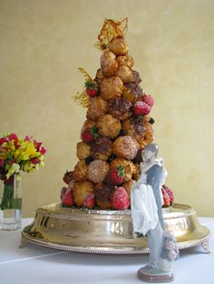 Croquembouche--French dessert is a cone shaped composition of choux pastry balls bound with caramel