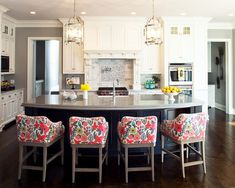 Cool Upholstered Bar Stools : Transitional Kitchen Design With Colorful Floral Pattern Upholstered Bar Stools With Back Also Elegant Kitchen Island Design With Gray Glossy Board Countertop Also Antique Pendant Lights And White Kithen Cabinet