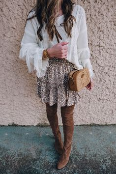 The cutest $28 fringe sweater find and how I styled it for a winter date night look with this cute skirt and my Stuart Weitzman over the knee boots.