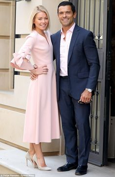 The perfect match! Kelly's dress matched her husband Mark Consuelos' button-down shirt