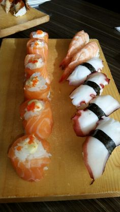 Octapus and shrimp sushi and salmon roses.