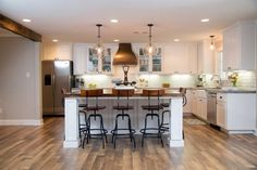 HGTV: A new kitchen island with a countertop made from the wood of an old train car offers additional counter space and a casual dining area.