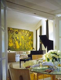"""""""Winona's New York apartment has eighteen-foot-high ceilings,"""" notes Haley. """"My idea was of something very glamorous."""" Lacquered panels made by Pierre Bobot in 1930 for the Manhattan dance club Roseland accent the living room. J. Robert Scott upholstery fabric. Karastan carpet. Table lamps from Donghia. Steinway piano."""