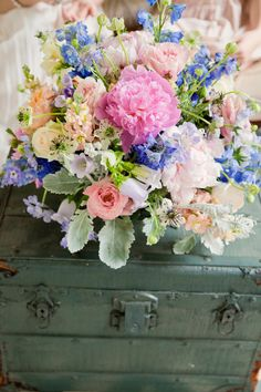 colorful floral arrangement by embellished blooms http://www.weddingchicks.com/2013/09/30/tea-party-bridal-shower/