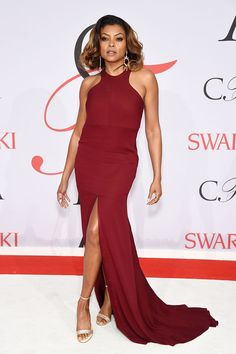 ef34b1bbe750 Taraji Henson in a burgundy prom dress at the red carpet of 2015 CFDA  Fashion Awards