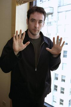 John Cusack ...... He is letting us know he is still a ten!  Lol