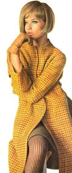 Veruschka is wearing a yellow-brown Tattersall coat, 1966