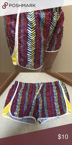 UnderArmour Women's Running Shorts semi-fitted heat gear underarmour running shorts. lightly worn. red pink yellow and blue with white inside. Under Armour Shorts
