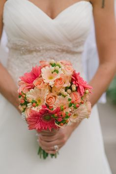 peach roses, pink gerbera daisies, peach hypericum berries. Would add calla lilies, stock, carnations, and lily grass