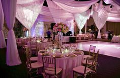 this draping makes the setting more intimate and distracts from wallpaper and banquet carpeting