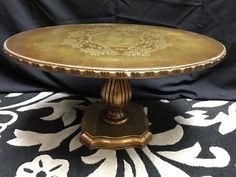 ITALIAN STYLE GILDED OCCASIONAL TABLE WITH BRUSHED GOLD TOP WITH STENCIL OVERLAY PATTERN AND RIBBED PEDESTAL BASE. 16H X 28W X 21D