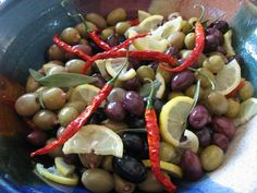 MEDITERRANEAN OLIVES WITH LEMON, BAY, AND PEPPERS.  This beautiful party appetizer is both eye catching and delicious.  It is designed for a large crowd of 25 or more, but could easily be reduced by half for a smaller gathering.  http://thebaldgourmet.com/recipe-mediterranean-olives-with-lemon-bay-and-pepper/